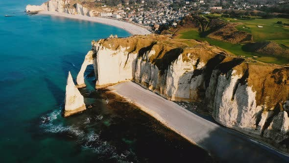 Thumbnail for Drone Panning Right Over Beautiful Sunset Town of Etretat in Normandy Revealing Famous White Chalk