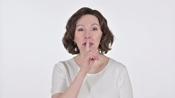Thumbnail for Old Woman with Finger on Lips on White Background