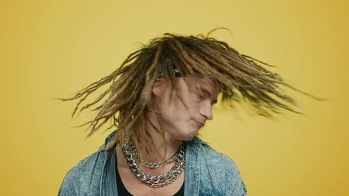 Rocker Waving Head on Yellow Background. Hipster Moving Body To Music