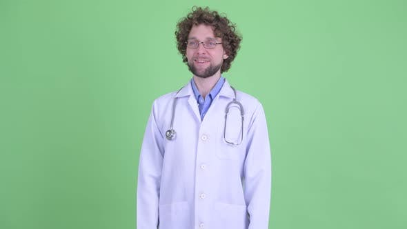 Thumbnail for Happy Young Bearded Man Doctor Smiling and Thinking