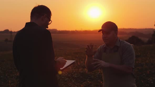 Thumbnail for Farmer Discussing with a Businessman in a Field