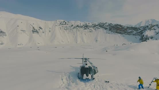 Thumbnail for Aerial view The skiers go to the helicopter in the snowy mountains