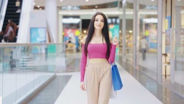 Slow Motion Woman Walking in Shopping Center