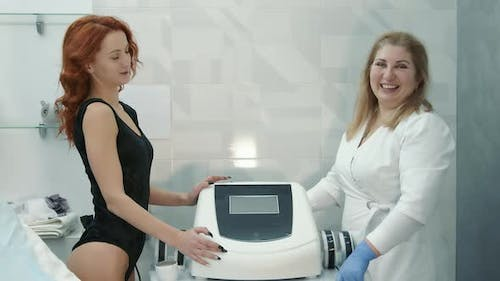 Portrait of a Doctor and a Patient in a Beauty Salon After a Session of Skin Rejuvenation and