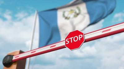 Barrier Gate Opens at Flag of Guatemala
