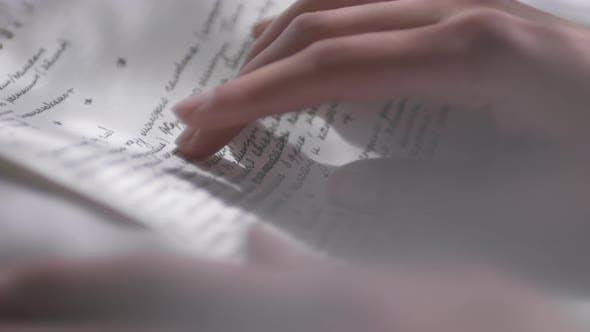 Woman Reading Handwritten Letter