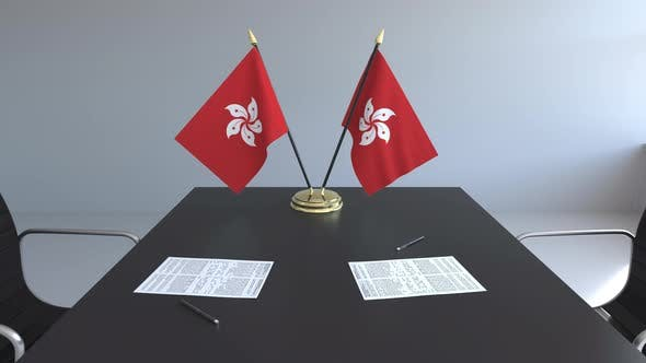 Thumbnail for Flags of Hong Kong and Papers on the Table