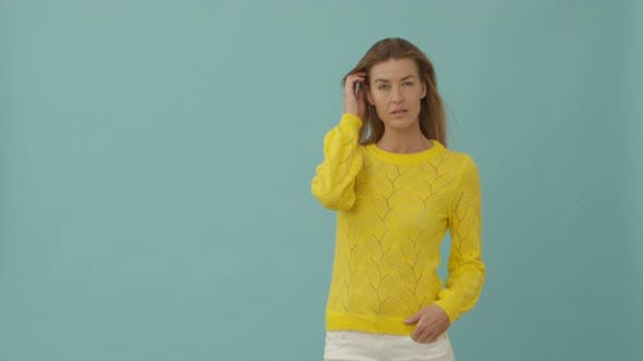 Thumbnail for Woman in Yellow Posing