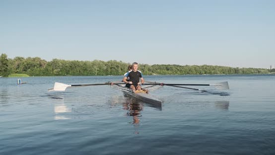 Cover Image for Active Healthy Lifestyle Teens. Boys 15, 16 Years Old Paddling Sport Kayak on Water