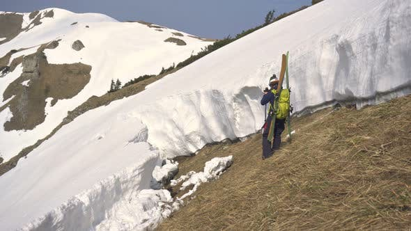 Thumbnail for Young Skier Shooting Video of Avalanche Gap in Snowy Alpine Mountains in Sunny Winter Season