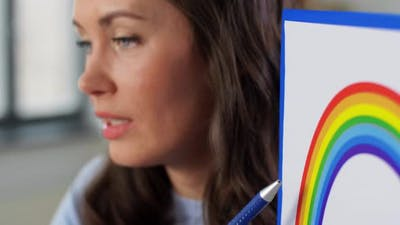 Teacher with Rainbow Having Online Class at Home