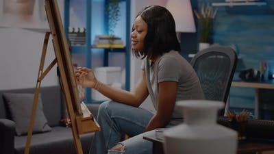 Black Young Adult with Creative Imagination Drawing