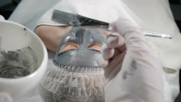 Thumbnail for View From Cosmetician at Young Woman Laying in Spa Beauty Salon with Dark Mask on Her Face. Beauty