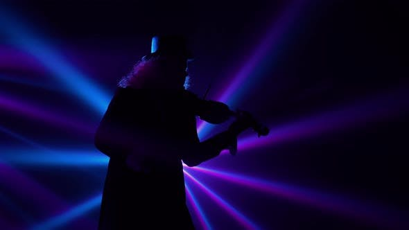 Bottom View Virtuoso Performance By a Violinist in a Dark Studio with Blinking Blue Violet Beams of