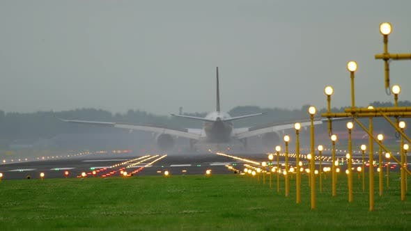 Cover Image for Airplane Landing at the Early Morning