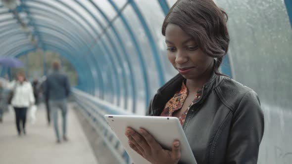 Cover Image for Student Working with Her Tablet in the Street, City Street, Subway
