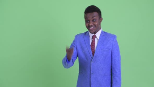 Thumbnail for Happy Young African Businessman Pointing Finger