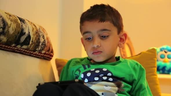 Thumbnail for Kid Using Tablet
