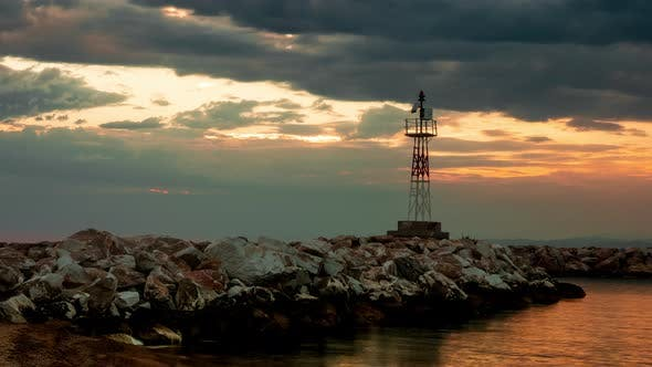 Thumbnail for Lighthouse on a Rocky Seashore During Sunset, Timelpse