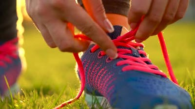 Running Shoes  Woman Tying Shoe Laces