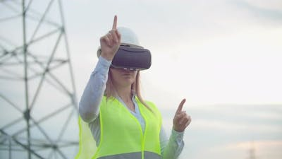 Highvoltage Power Lines Controlled By a Female Engineer Using Virtual Reality to Control Power