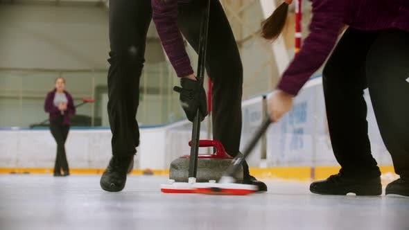 Thumbnail for Curling Training Indoors - Leading Granite Stone on the Ice - Rubbing the Ice Before the Stone