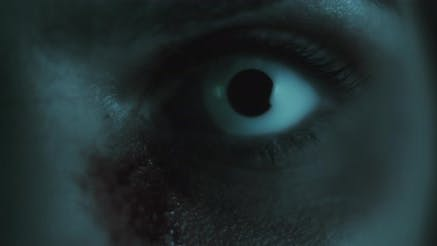 Thumbnail for Terrifying creepy zombie woman, close up of white eye opening. Scary look.