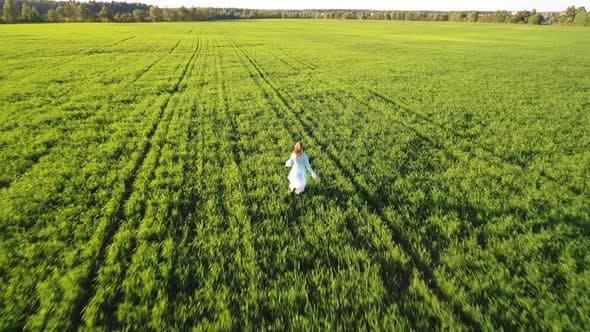 Thumbnail for Girl Running On Sunlight Field