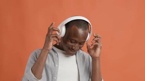 Happy Black Guy Enjoying Music in Headphones, Dancing