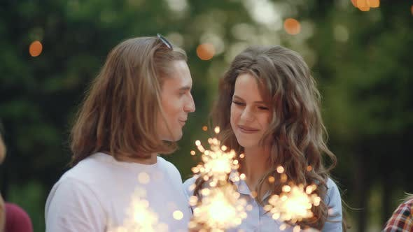 Young People At Celebration Party With Sparklers