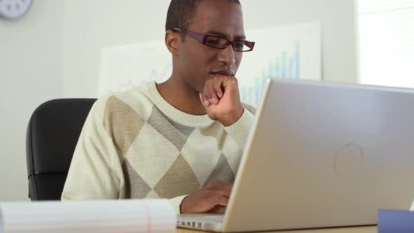 Thumbnail for African American office worker using laptop computer