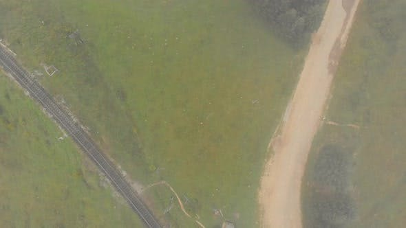 Top View of Railroad Track on Misty Morning