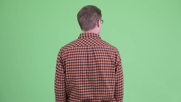 Thumbnail for Rear View of Young Hipster Man Waiting and Thinking