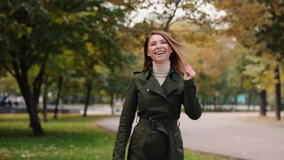 Happy Woman Smiling at the Autumn Day Slow Motion