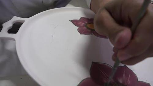 Artist Paint On Plate Flower Figure Working