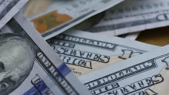 Rotating stock footage shot of $100 bills - MONEY 0138