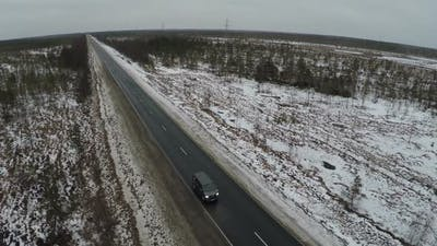 Car Driving on the Route in Winter