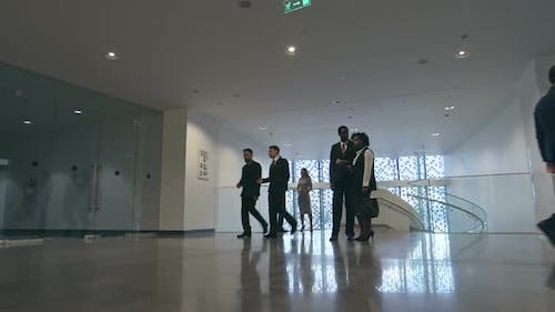 Businesspeople in Lobby of Modern Business center