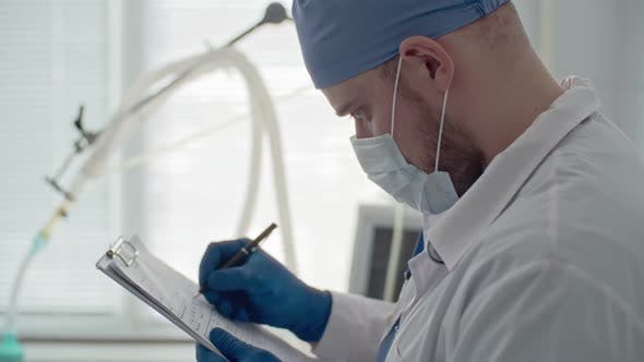Thumbnail for Doctor Writing Medical History