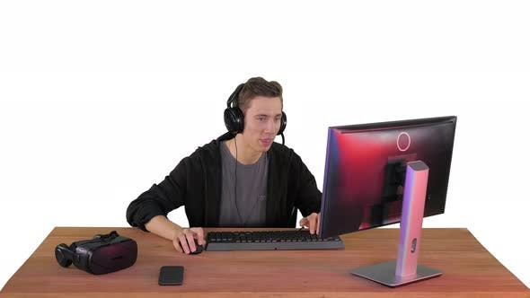 Thumbnail for Professional Gamer Plays Video Game on His Computer and Commenting His Stream on White Background