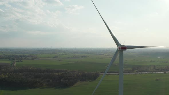 Thumbnail for AERIAL: Close Up Shot of Wind Mill Rotating By the Force of the Wind and Generating Renewable Energy