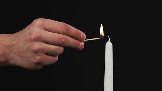 Thumbnail for Hand firing a candle