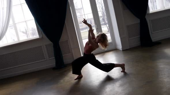 Young Female Dancer is Rehearsing Alone in Rehearsal Room Amazing Contemporary Choreography