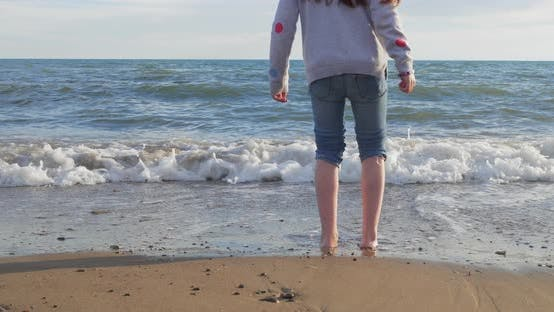 Thumbnail for Little Girl Playing on the Beach in Summer