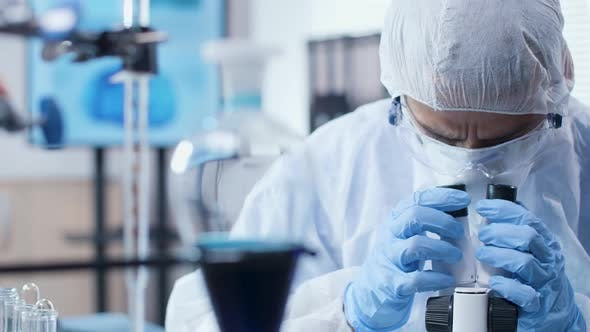Cover Image for Dolly Shot of Scientist Looking Into a Microscope in Modern High End Laboratory