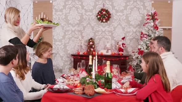 Thumbnail for Big Family Gathered Around Christmas Table Enjoying Traditional Food