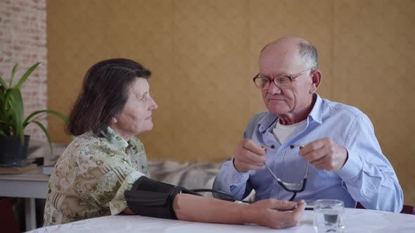 Thumbnail for Elderly Caring Man Checks Blood Pressure of His Old Wife with Hypertension Using a Blood Pressure