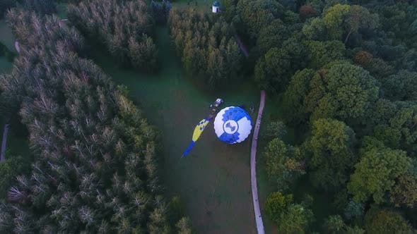 Thumbnail for Pilots Raising Envelope of Hot Air Balloon, Basket on Ground, Preparation