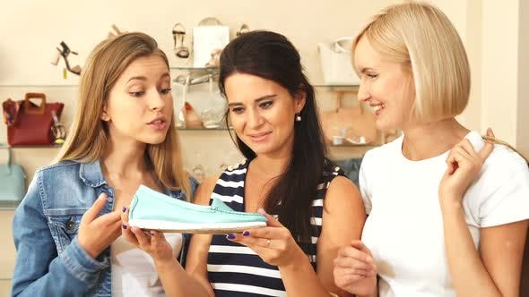 Thumbnail for Women See Expensive Shoe in Shoe Shop