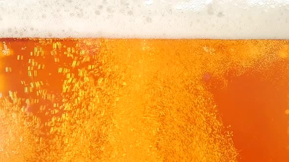 Cover Image for Light Beer Is Poured in a Glass. Closeup. Slow Motion